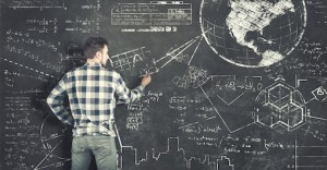 Teenager solving some math problems on blackboard